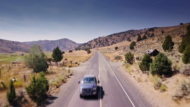 flight along country road through izee, oregon - rural scene stock videos & royalty-free footage