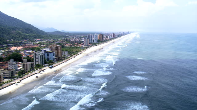 flight along solemar beach and resort  - aerial view - são paulo,praia grande,brazil - são paulo state stock videos & royalty-free footage