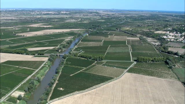 flight along the river audecanal du midi  - aerial view - languedoc-roussillon, aude, arrondissement de narbonne, france - aude stock videos & royalty-free footage