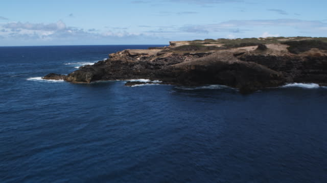 Flight along the rocky coastline of Molokai