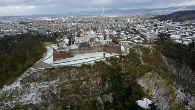 Flight along the western side of the Brasov Citadel; early winter