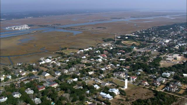 flight and pan across sullivan island  - aerial view - south carolina,  charleston county,  united states - island stock videos & royalty-free footage