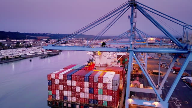 flight around container ship being loaded in port of tacoma - cargo container stock videos & royalty-free footage