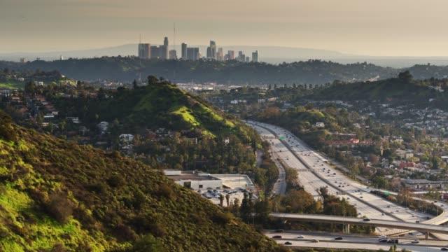 flight around hillside to reveal freeway interchange in eagle rock, los angeles - glendale california stock videos & royalty-free footage