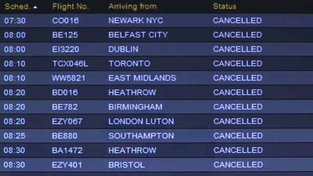 Flight arrivals board at Glasgow airport showing all flights cancelled due to ash from Icelandic volcano eruption, Scotland, May 2010