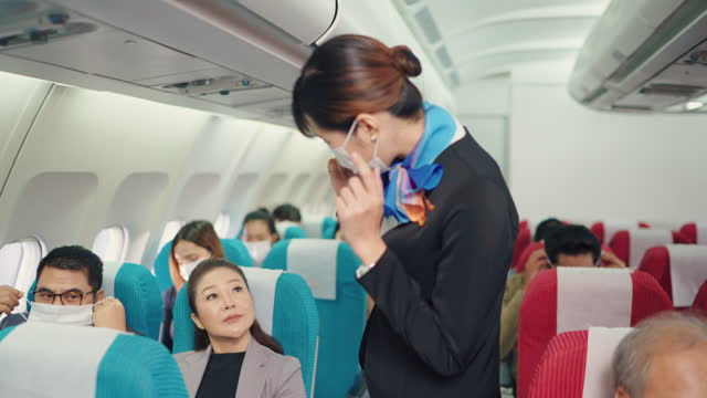 flight attendant checking everyone wearing their protective face mask - crew stock videos & royalty-free footage