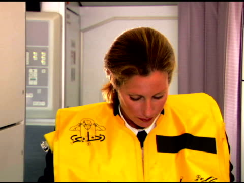 flight attendant demonstrating safety - instructions stock videos & royalty-free footage