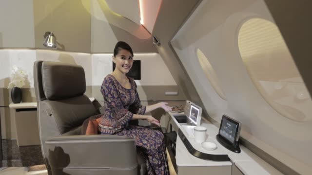 flight attendant gives a demonstration in a mock-up suite, designed by pierrejean design studio, during the unveiling of the new cabins for the... - inch stock videos & royalty-free footage