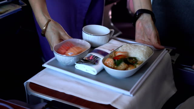 flight attendant serving food on board - crew stock videos & royalty-free footage
