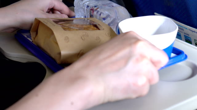 flight attendant serving snacks - air stewardess stock videos & royalty-free footage