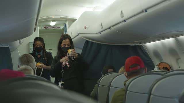 flight attendants demonstrate a safety procedure on a united flight during the coronavirus pandemic at baltimore washington international airport on... - mid air stock videos & royalty-free footage
