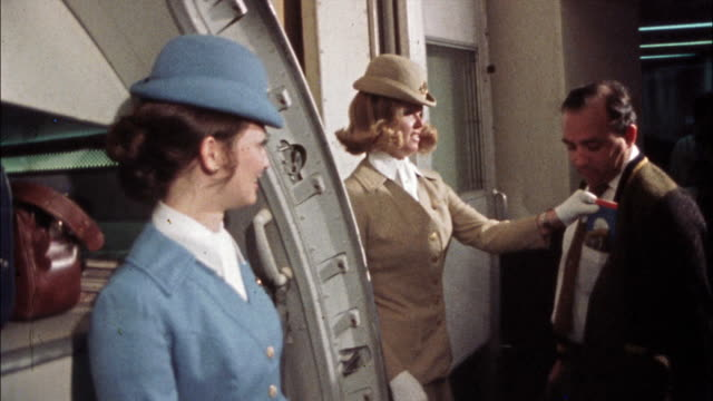 flight attendants greet passengers as they board an airplane. - uniform stock videos & royalty-free footage