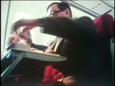 flight attendants serve a meal in a 747. - crew stock videos & royalty-free footage