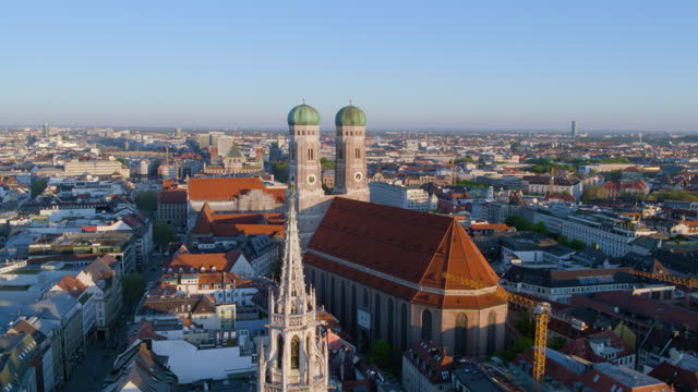 flight away from church of our lady - rathaus stock videos & royalty-free footage