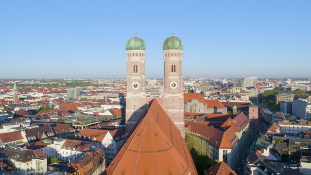 flight backward over church of our lady towers in morning light - rathaus stock videos & royalty-free footage