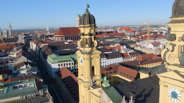 flight backward through theatiner church towers - rathaus stock videos & royalty-free footage