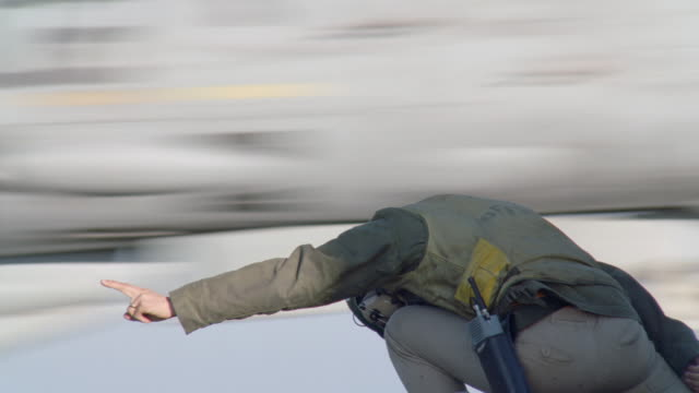 a flight crew personnel signaling to an f 14 aircraft as it takes off. - aircraft carrier stock videos & royalty-free footage