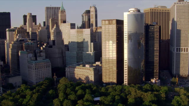 flight east from battery park around tip of manhattan. shot in 2006. - artbeats stock videos & royalty-free footage