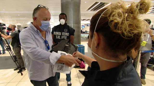 """flight from rome to milan where compulsory coronavirus testing is being trialled before some flights to avoid mass quarantine - """"bbc news"""" stock videos & royalty-free footage"""