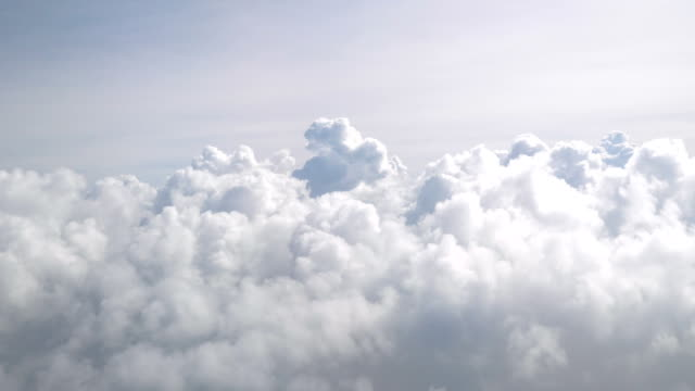 flight in the clouds in 4k - panorama di nuvole video stock e b–roll