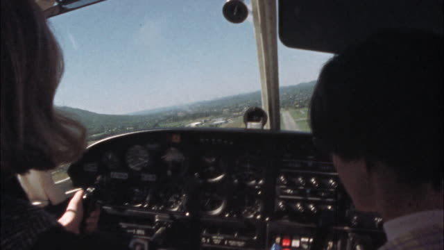 a flight instructor talks to a student pilot during a landing. - captain stock videos & royalty-free footage