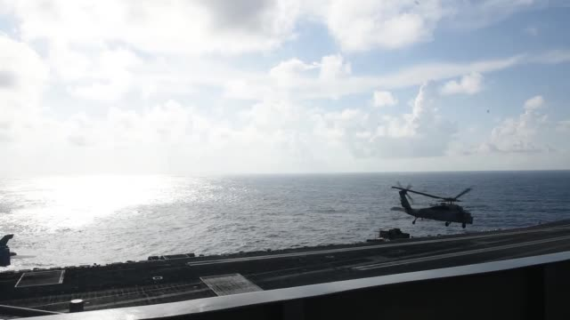 flight operations aboard us navy forwarddeployed aircraft carrier uss ronald reagan in south china sea - south china sea stock videos & royalty-free footage