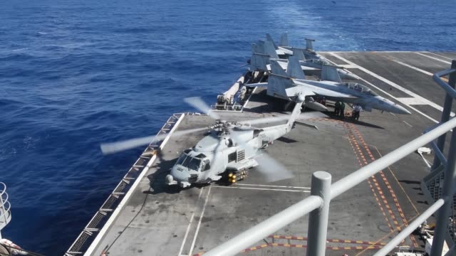 flight operations aboard us navy forwarddeployed aircraft carrier uss ronald reagan in south china sea - aereo militare video stock e b–roll