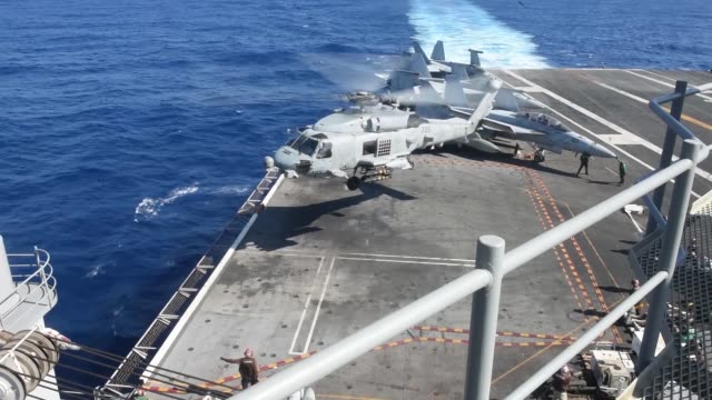 flight operations aboard us navy forwarddeployed aircraft carrier uss ronald reagan in south china sea - warship stock videos & royalty-free footage