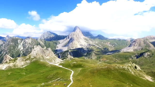 flight over a green valley in the alps, aerial view - collina video stock e b–roll