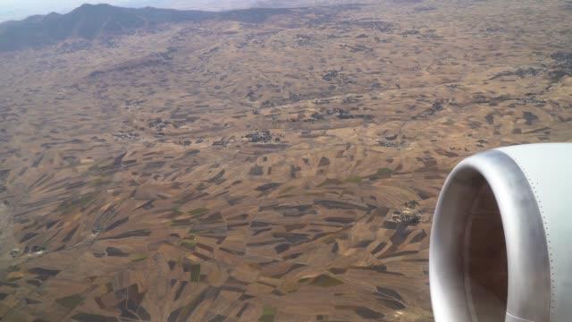 flight over agricultural villages of  ethiopia - エチオピア点の映像素材/bロール