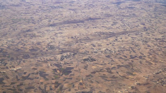 flight over agricultural villages of  ethiopia - ethiopia stock videos & royalty-free footage