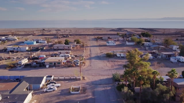 flight over bombay beach towards the salton sea - bad condition stock videos and b-roll footage