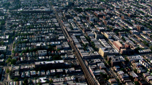 flight over brooklyn, with railway cutting in center frame. shot in 2003. - artbeats stock videos & royalty-free footage