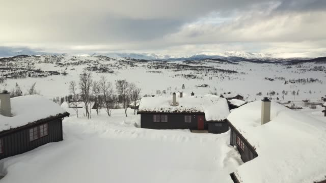 flight over cabins in norway on a cloudy winter day. - log cabin stock videos & royalty-free footage