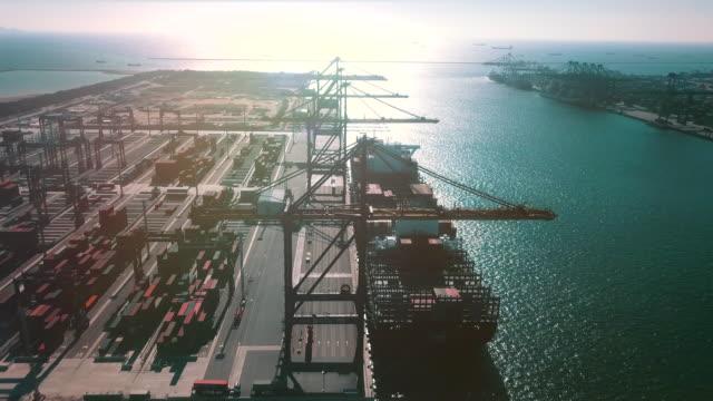 flight over cargo ship at sunset - long beach california video stock e b–roll