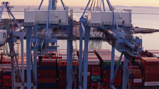 Flight Over Cargo Ship in Port