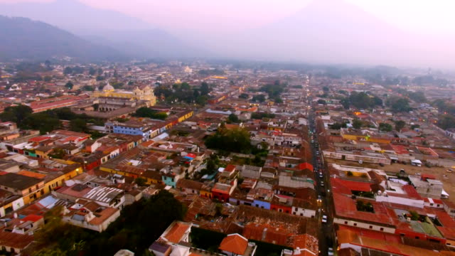 flight over city of antigua close to la merced church, guatemala - guatemala stock videos & royalty-free footage