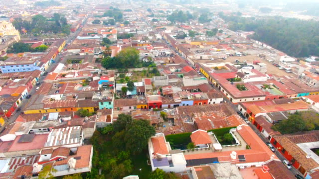 flight over city of antigua, guatemala - agua stock-videos und b-roll-filmmaterial