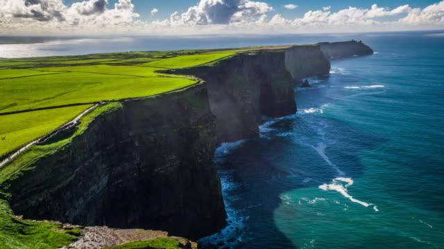 flight over cliffs of moher in ireland - irlanda video stock e b–roll