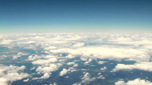 Flight over clouds, aerial view