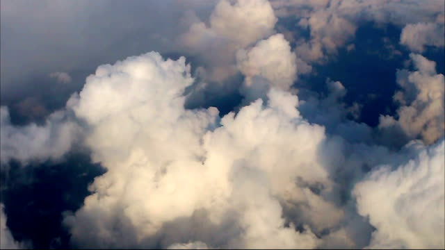 Flight over clouds, airplane view