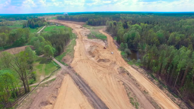 aerial flight over construction site - bulldozer stock videos & royalty-free footage