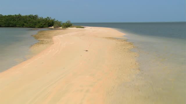 flight over florida coastal sandbars, along beach, and over seaside trees - artbeats stock videos & royalty-free footage