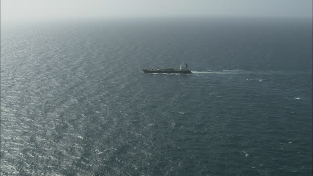 Flight Over Gas Freighter In Channel