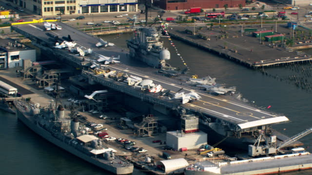 flight over hudson river and uss intrepid for view of manhattan. shot in 2003. - warship stock videos & royalty-free footage