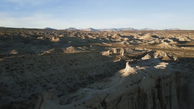 flight over interesting rock formations and vast desert landscape - red rocks stock videos and b-roll footage