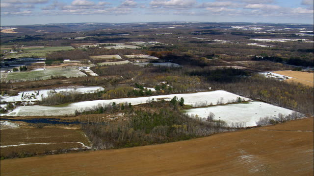 Flight Over Landscape With Dusting Of Snow - Aerial View - New York,  Tompkins County,  United States