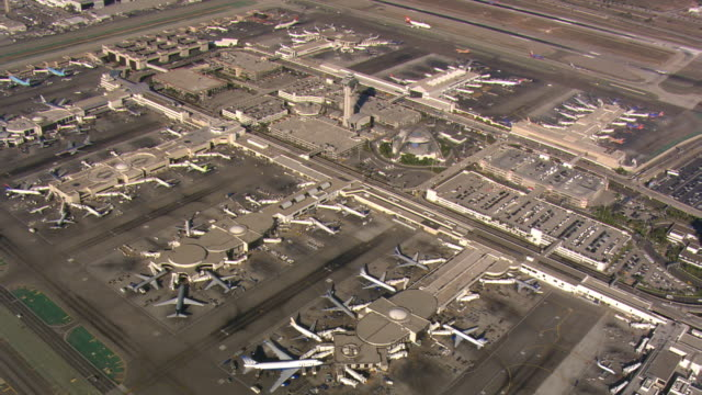 flight over los angeles international airport. shot in 2008. - lax airport stock videos & royalty-free footage
