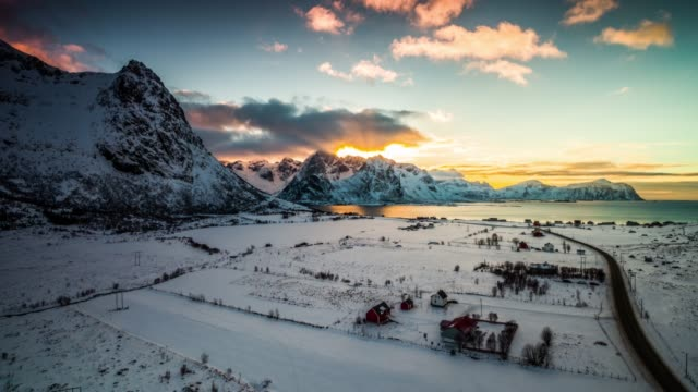 flight over nordic winter landscape under moody sunset sky, lofoten islands in norway - drone point of view stock videos & royalty-free footage