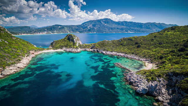 flight over porto timoni beach in corfu, greece - idyllic stock videos & royalty-free footage